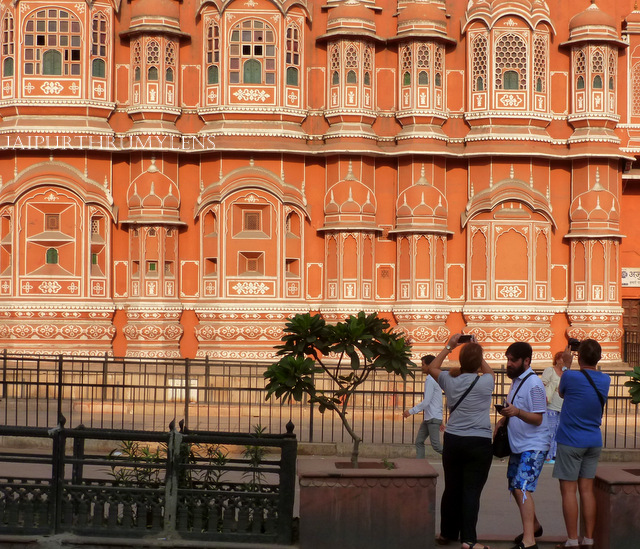 tourists capturing picture of hawa mahal jaipur