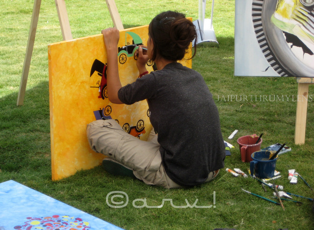 artist painting automobile art at cartist jai mahal palace jaipur