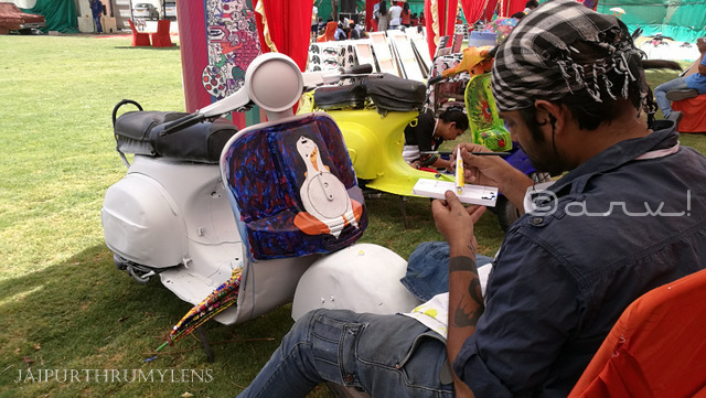 artist painting bajaj scooter at cartist jaipur jai mahal palace