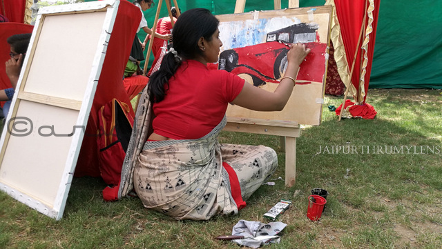 artist painting canvas at cartist jaipur