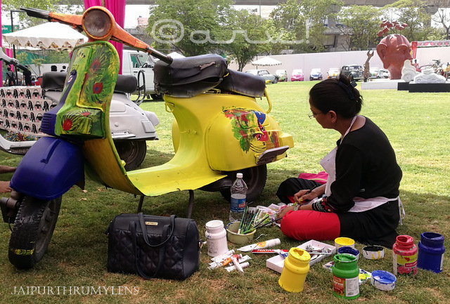 female artist painting scooter at cartist jaipur event jaipurthrumylens