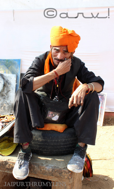 indian man in orange turban kala mahotsav jaipur