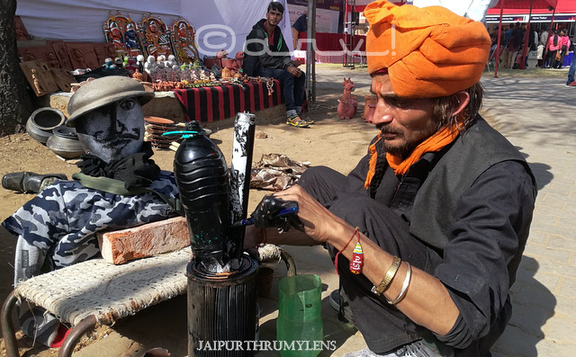 Indian artist in orange turban at kala mahotsav jaipur