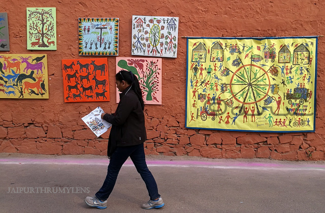 woman-walking-jaipur-literature-festival-hotel-diggi-palace-tribal-painting