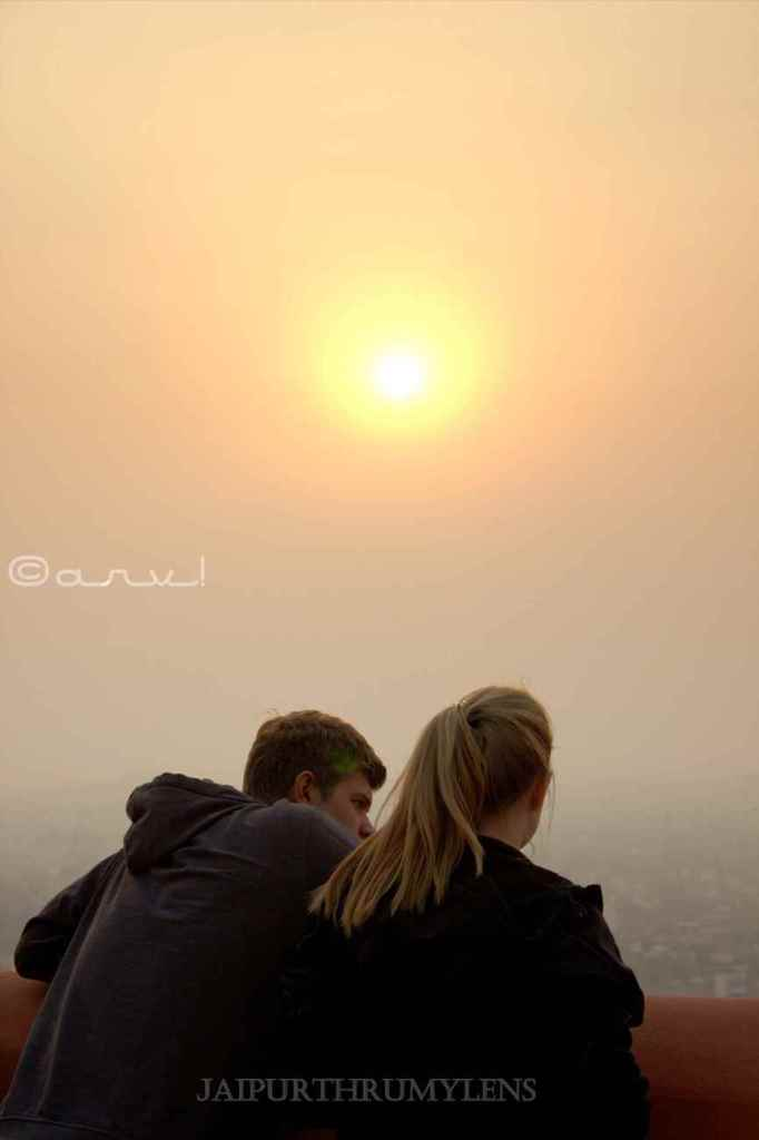 couple-watching-sunset-point-jaipur-city-view-sun-temple