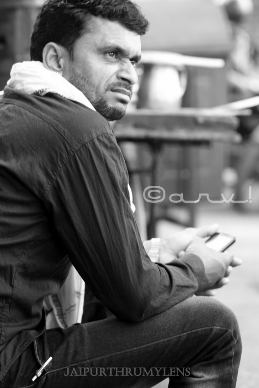 man-sitting-street-photography-walk-jaipur