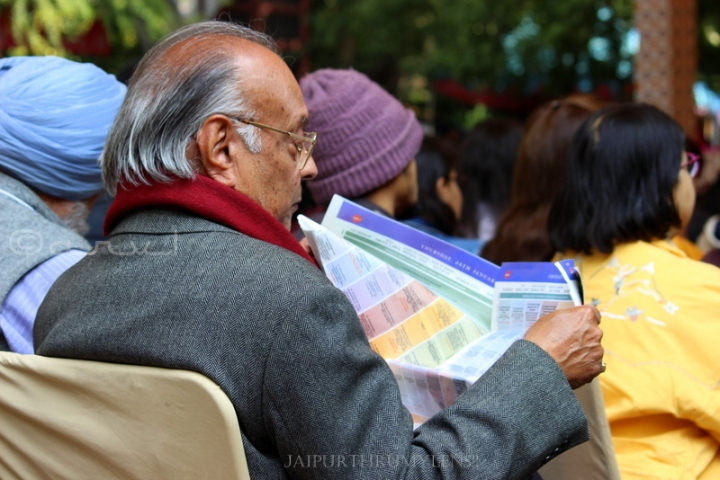old-man-reading-brochure-jaipur-literature-festival