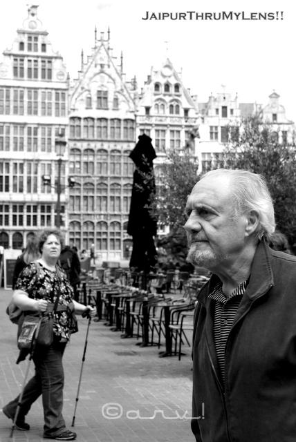 man-walking-street-photography-belgium