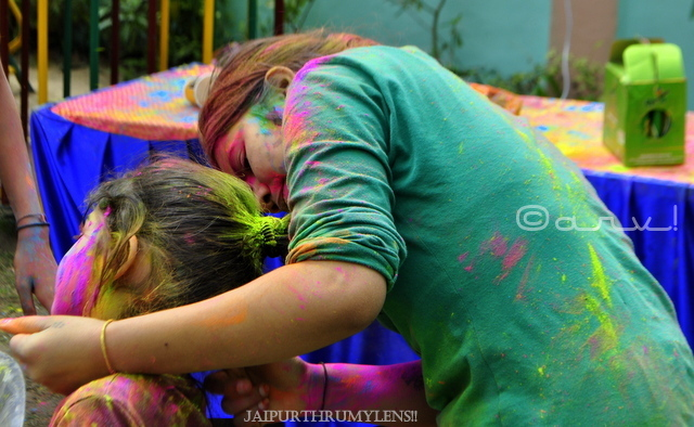 kids-applying-colour-holi-festival-celebration-jaipur-india