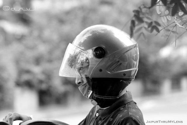 boy-with-face-mask-and-helmet-indian-street-photography-candid